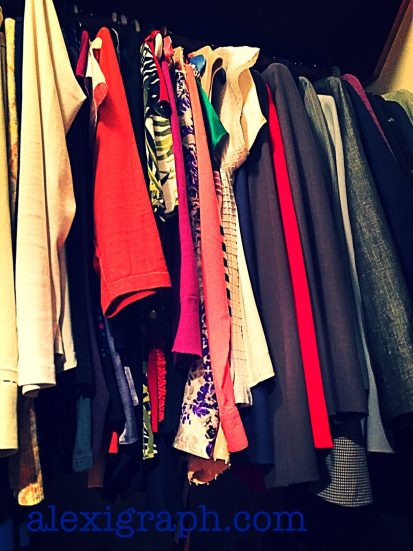 More clothes hanging in a closet