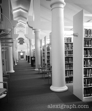 Black and white photo of stacks in a library