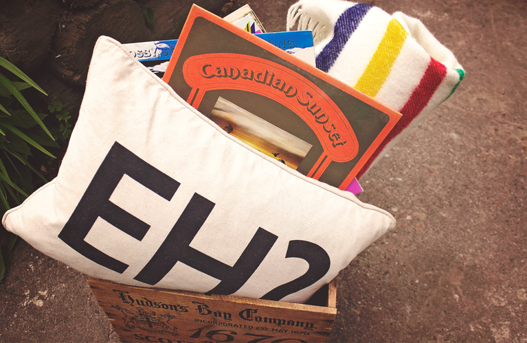 "Canada Day Essentials. ""Eh"" pillow, Hudson's Bay pointe blanket, Hudson's Bay vintage crate, Canadian Vinyl 