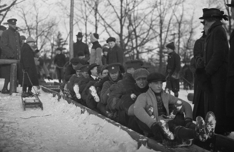One Hundred Christmases Ago -Toboggan on slides with soldiers and civilians, in High Park [Toronto, Ont.], 19 February, 1916