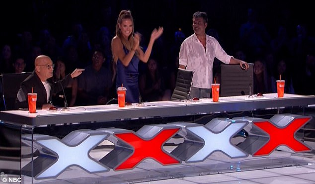 Mel B throws cup of water at Simon Cowell and storms off America's Got Talent after he cracked crude wedding night joke