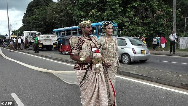 59c653f38741a - Sri Lankan couple being investigated for using 250 children to carry 2-mile long wedding dress, while another 100 served as flower girls (Photos/Video)