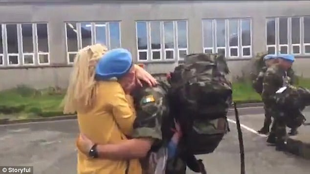 The heart-warming moment a little girl rushes to kiss her soldier father after he returns home but her brother is so overcome with emotion he can?t move