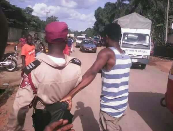 Photo: What could this FRSC official have done to warrant such manhandling?