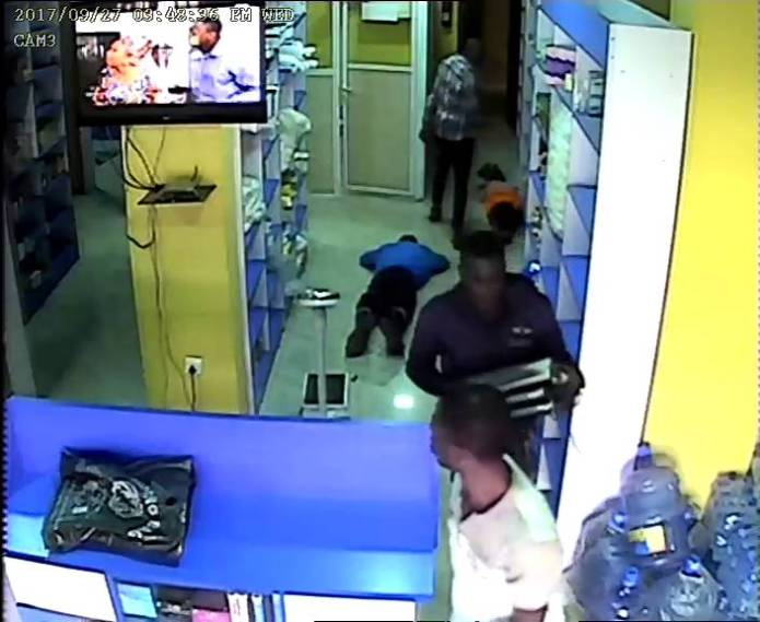 Stealing codeine or cash? Robbers break into a pharmacy in Idimu, Lagos (photos)