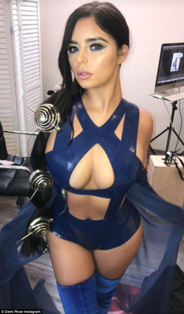 Demi Rose sends fans wild as she flaunts her jaw-dropping cleavage in racy PVC costumes (Photos)