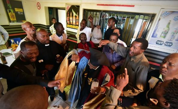 Photos from a South African church where members drink during service and are also baptized with their favorite beer