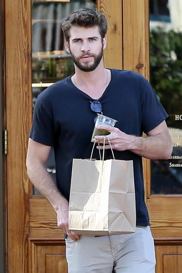 Miley Cyrus and Liam Hemsworth pictured wearing wedding rings on coffee run fuel rumor they married in secret