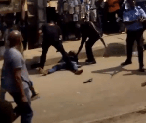 police officers beat up a man