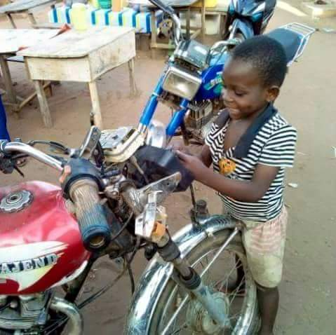 Photos: See this 8-year-old Ugandan boy who owns a motorcycle repair workshop