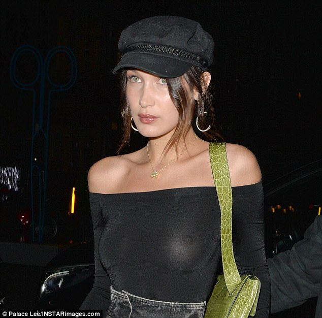 Braless Bella Hadid steps out in daring see-through top for dinner in London (Photos)