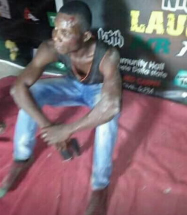 Man who stabbed a lady with dagger and snatched her phone at an event in Delta state, beaten up and handed over to the police