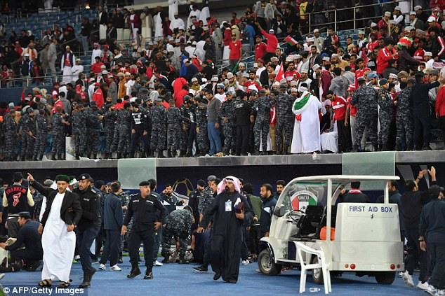 Over 30 football supporters injured after stadium