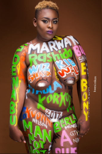 Ghanaian lady poses completely nude with a body paint of names of Ghanaian celebs and events of 2017 (18+ photos)