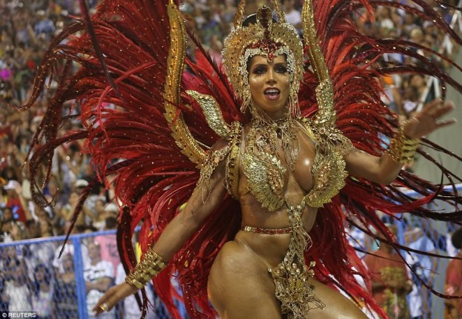 5a82e8da704d6 - 20 photos of Half-naked Brazilian dancers in sparkly G-strings & skimpy wears as they flood the street for Rio carnival (Photos)
