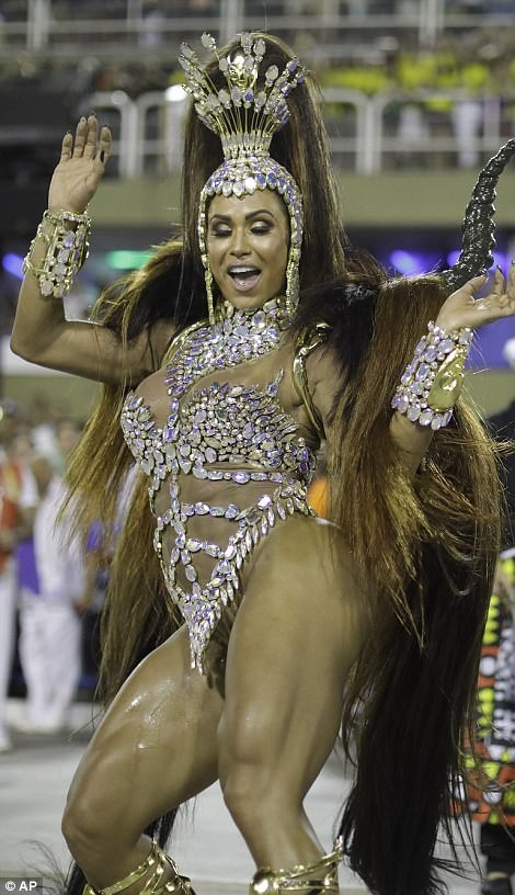 5a82e9233749a - 20 photos of Half-naked Brazilian dancers in sparkly G-strings & skimpy wears as they flood the street for Rio carnival (Photos)