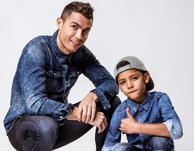 5a830cd31fca2 - Father & Son: Cristiano Ronaldo and Cristiano Jr rock matching denim to promote their new clothing campaign (Photos)
