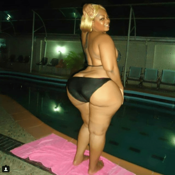 Over-endowed Ivorian actress shows off her bikini body by the pool in Nigeria
