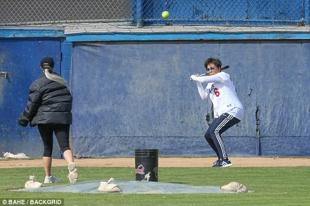 5a85658299f0e - Pregnant Khloe Kardashian cradles her growing bump while watching her sisters play softball with their mom  (Photos)