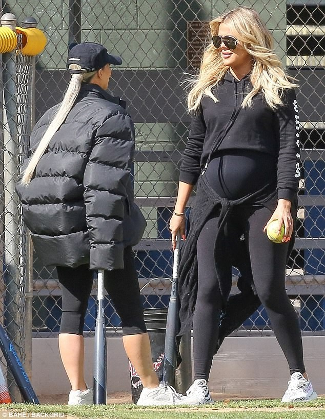 5a8566111f48b - Pregnant Khloe Kardashian cradles her growing bump while watching her sisters play softball with their mom  (Photos)