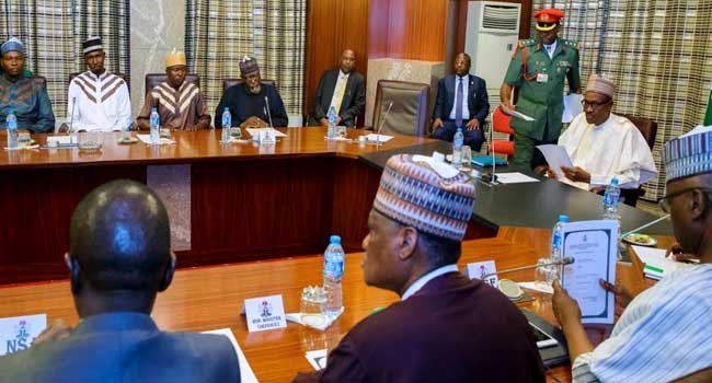 Photos: President Buhari meets with released UNIMAID lecturers, others