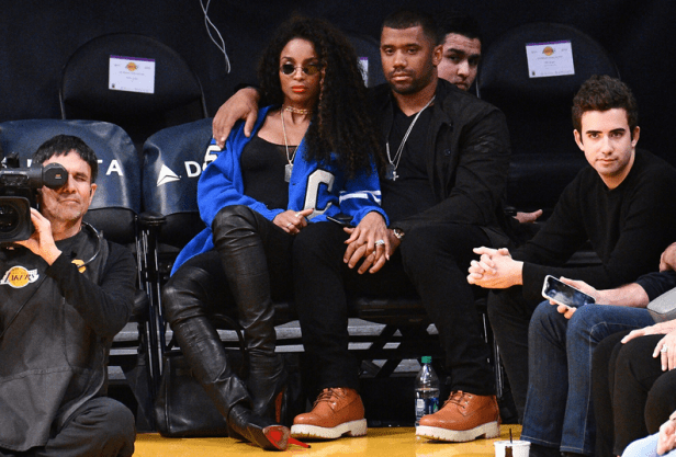 Ciara gets kisses from her husband as they watch basketball game together (photos)