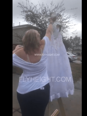 Woman happily celebrates her divorce by setting her wedding dress on fire (video)