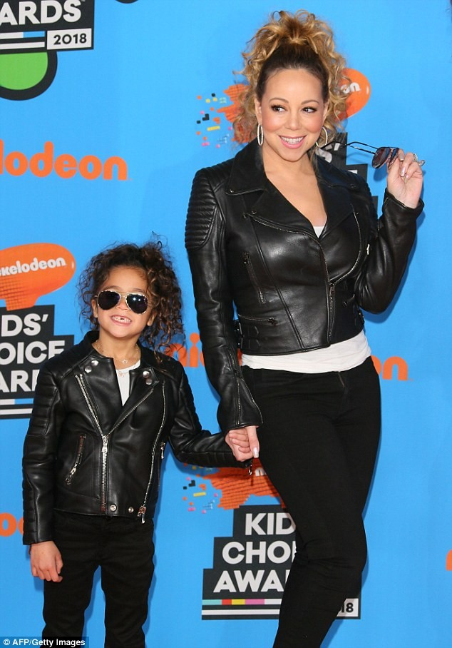 Mariah Carey and her ex Nick Cannon wear matching outfits with their children to Kids