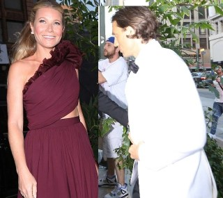 Actress Gwyneth Paltrow and Brad Falchuk hold