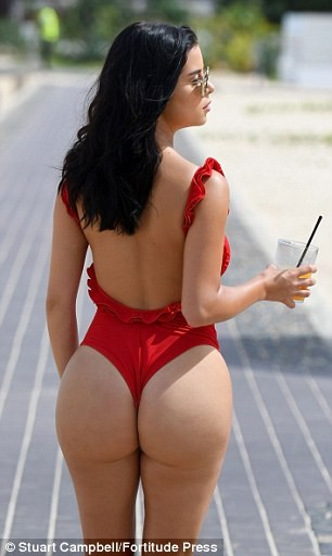 Demi Rose parades her ample assets in skimpy swimsuit (Photos)