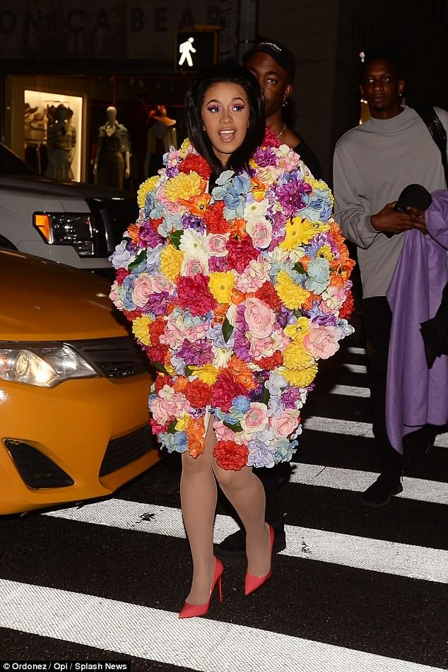 Pregnant Cardi B covers her baby bump with colourful floral coat as she steps out with friends in New York (Photos)