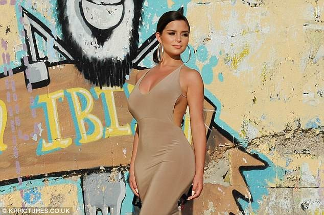 Demi Rose flaunts serious sideboob and curves in figure-hugging nude dress? (Photos)