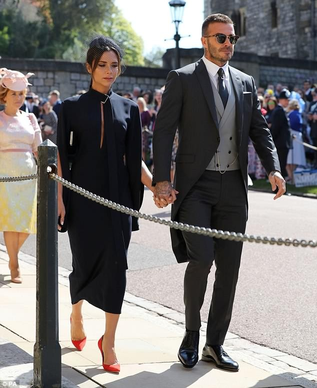 #RoyalWedding: Victoria Beckham stuns in navy blue dress as she joins husband David for Prince Harry and Meghan Markle