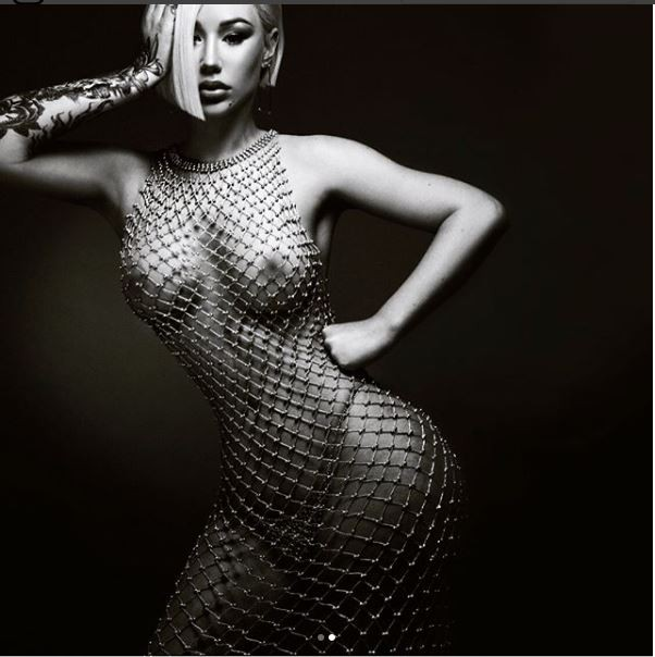 Iggy Azalea shares more nude photos of herself wearing only a beaded mesh dress