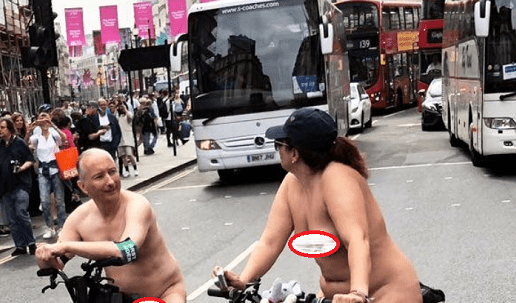 Photos: Naked couple spotted riding bicycles in busy London road 18+