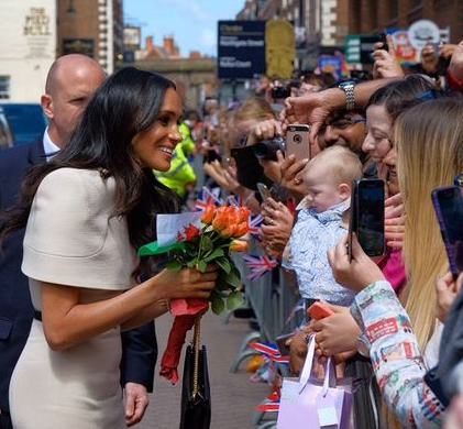 Meghan Markle gushes over Prince Harry as she tells fans 'he's the best husband ever'
