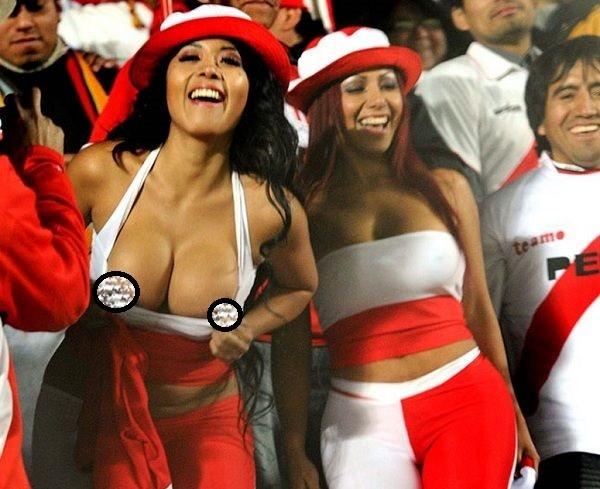 Photos of Peru female fans flashing their boobs during World Cup clash against Denmark..
