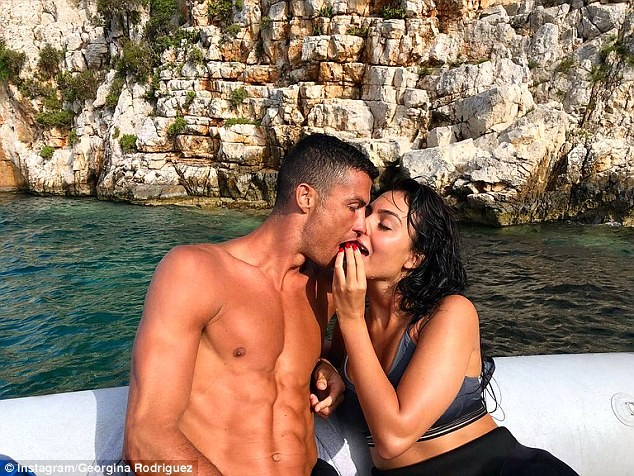 Cristiano Ronaldo lock lips with his girlfriend Georgina as they enjoy family holiday ahead of his