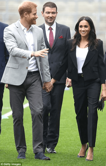 Meghan Markle quickly changes to sleek trouser suit for symbolic Croke Park tour