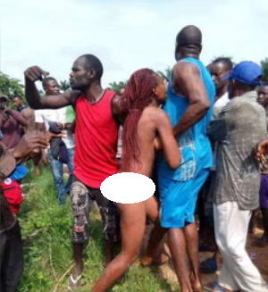 Married woman caught pants down with her ex, who is also married, are paraded naked and beaten in Enugu (photos)