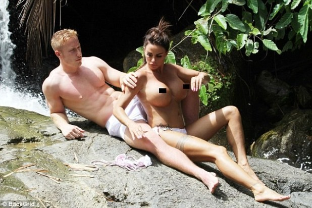 Katie Price, 40, strips completely topless and puts on a very X-rated display with toyboy beau Kris Boyson during waterfall visit in Thailand (Photos)