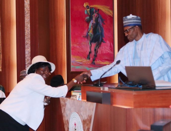 Photos:?President Buhari swears-in former IG, Musiliu?Smith as chairman of Police Service Commission