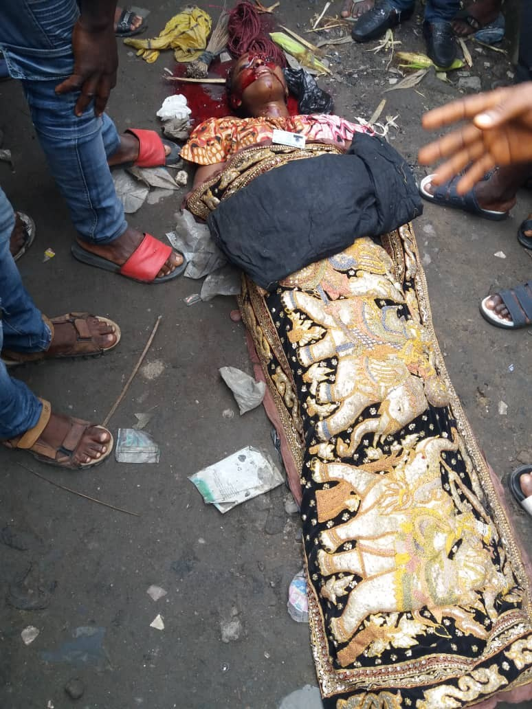 Graphic photos: Armed robber set ablaze after shooting lady dead outside a bank in Lagos