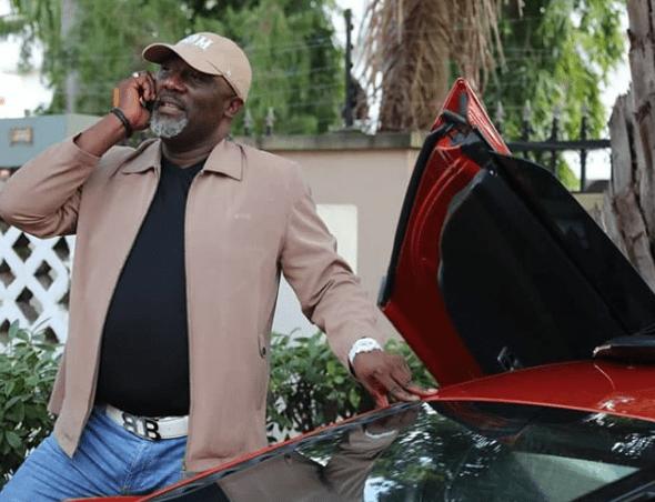 Dino Melaye shares photos of himself posing beside his Ferrari