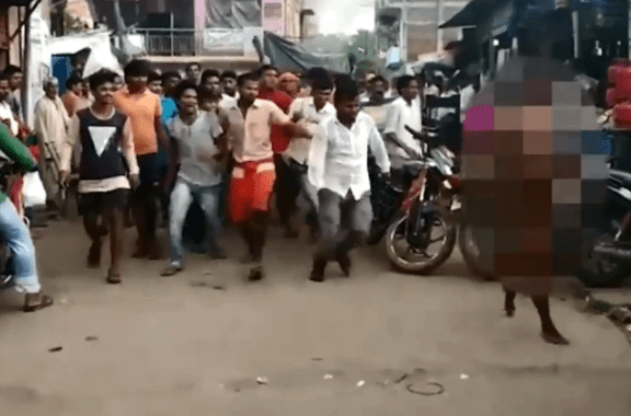 Video: A woman thrashed, paraded naked on streets on