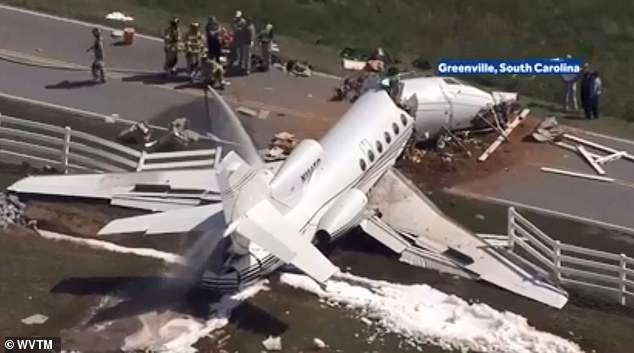Two pilots dead and passenger couple critically injured after private jet speeds off runway and crashes into fence, breaking into two