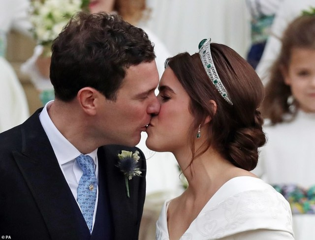 Beaming Princess Eugenie and her new husband Jack Brooksbank share a kiss as they emerge from Windsor Castle chapel (photo)