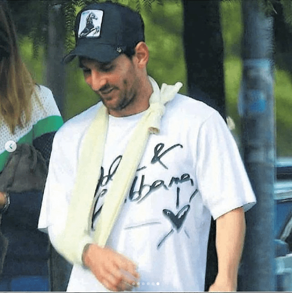 Injured Lionel Messi pictured wearing sling for the first time after breaking his arm (Photos)