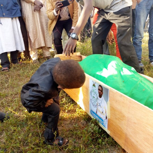 Heartbreaking photos of a little boy staring at the photo of his Dad killed during the Shiite/Security agents clash in Abuja