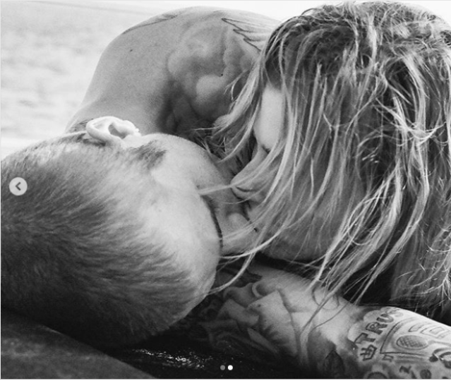 Justin Bieber and his wife Hailey Baldwin share a kiss on the beach in racy new photos